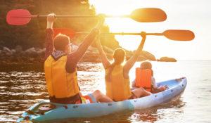 family using a kayak